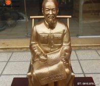 tuong_dong_bac_ho_ngoi_doc_bao_60cm.jpg